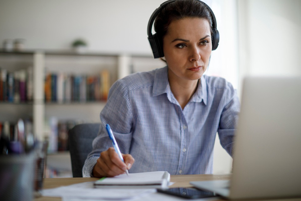 woman at computer with headset