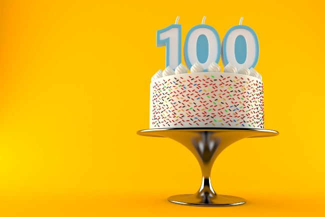 a cake with candles showing 100