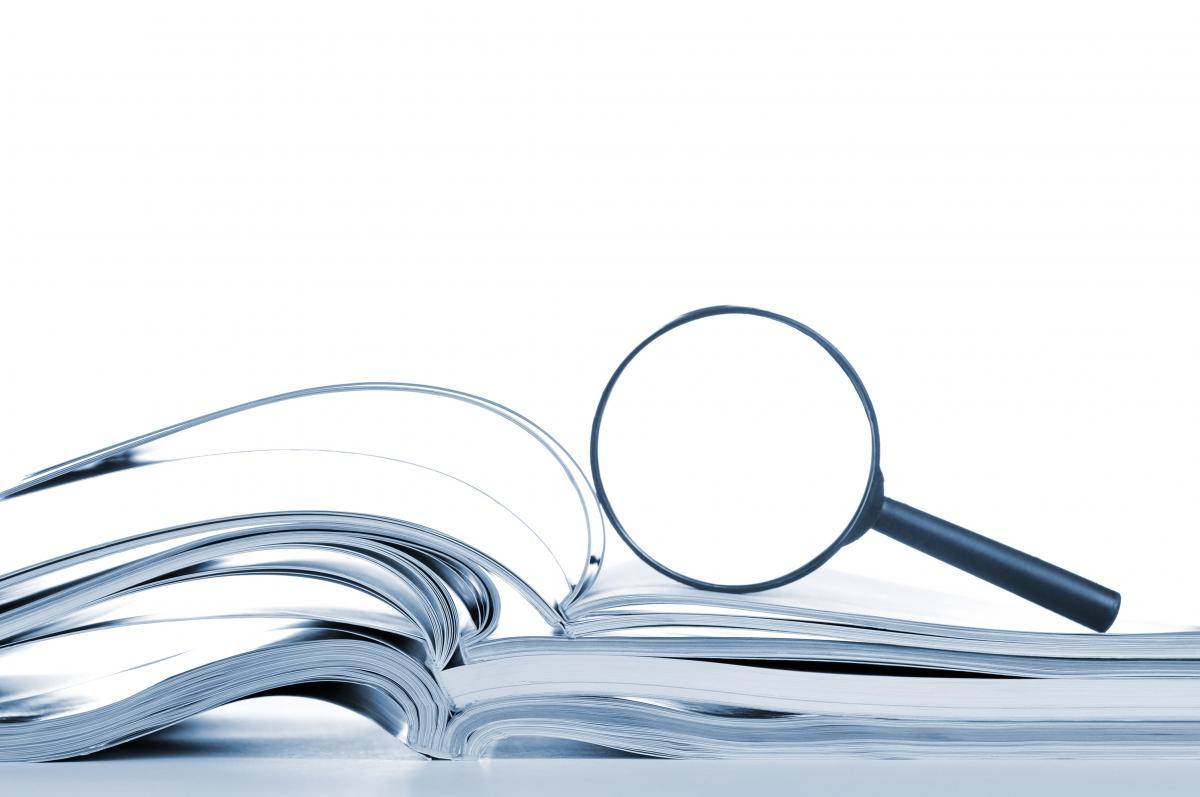 magnifying glass on top of book